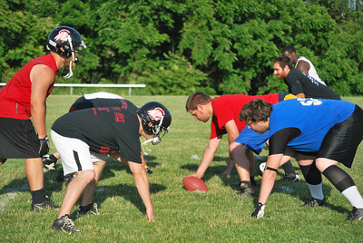 Amanda August/For The Daily Item The Susquehanna Valley Seminoles practice before a game this Sunday in Northumberland on Friday night.