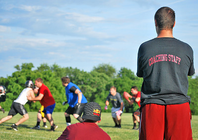 Amanda August/For The Daily Item Susquehanna Valley Seminoles coaches Mike Harold and Zane Simpson watch as the football team practice on Friday night in Northumberland.