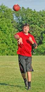 Amanda August/For The Daily Item Brian Schroyer, of Shamokin, throws a pass during practice for the Susquehanna Valley Seminoles on Friday night in Northumberland.