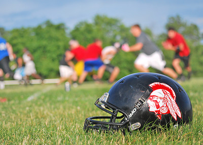 Amanda August/For The Daily Item A helmet for the Susquehanna Valley Seminoles football team sits on the sideline while the team practices on Friday night in Northumberland.