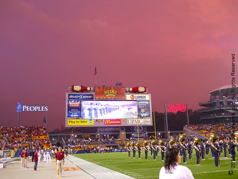 Not a retouched photo.  After the front passed to the east and the sun headed down in the west, right before the beginning of the game, the setting sun cast this glow on the receding thunderheads.  Nice.