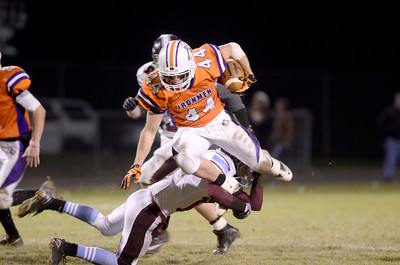 Danville's Isaiah Croll goes airbone on a carry up field during Friday's District 4 AA playoff game.