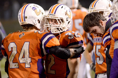 Danville's Caleb Klien consoles teammate Sam Dressler at the end of Friday's game against Troy in the District 4 Class AA title game.