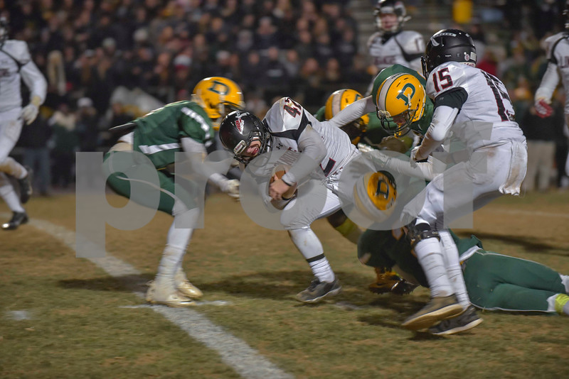 Dragging Jake Funk and other Damascus players, Chris Connec stays on his feet and moving forward.