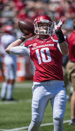 Senior Quarterback Brandon Allen passes during the pre-game practice prior to the Arkansas Red-White Spring Football Game on Saturday, April 25, 2015 in Fayetteville, Arkansas at Donald W. Reynolds Razorback Stadium.  The Red team won 62-18 in front of an official attendance of 41,220 fans.   (Alan Jamison, Nate Allen Sports Service)