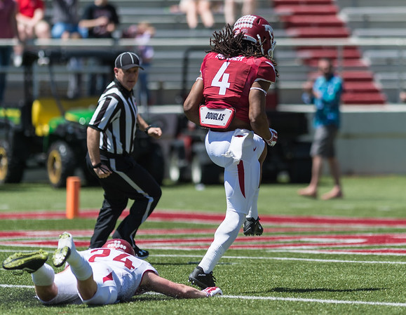 Senior Wide Receiver Keon Hatcher outruns Defensive Back Ryder Lucas during the Arkansas Red-White Spring Football Game on Saturday, April 25, 2015 in Fayetteville, Arkansas at Donald W. Reynolds Razorback Stadium.  The Red team won 62-18 in front of an official attendance of 41,220 fans.   (Alan Jamison, Nate Allen Sports Service)