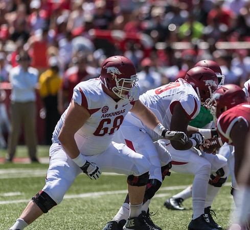 Offensive Lineman Austin Beck prepares to protect the quarterback during the Arkansas Red-White Spring Football Game on Saturday, April 25, 2015 in Fayetteville, Arkansas at Donald W. Reynolds Razorback Stadium.  The Red team won 62-18 in front of an official attendance of 41,220 fans.   (Alan Jamison, Nate Allen Sports Service)