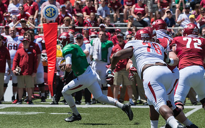Sophomore Defensive Tackle Bijhon Jackson chases the quarterback during the Arkansas Red-White Spring Football Game on Saturday, April 25, 2015 in Fayetteville, Arkansas at Donald W. Reynolds Razorback Stadium.  The Red team won 62-18 in front of an official attendance of 41,220 fans.   (Alan Jamison, Nate Allen Sports Service)