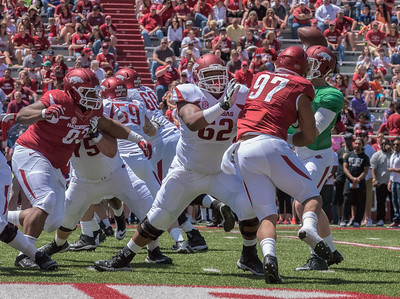 Junior Offensive Lineman Johnny Gibson blocks Sophomore Defenseve End Tevin Beanum during the Arkansas Red-White Spring Football Game on Saturday, April 25, 2015 in Fayetteville, Arkansas at Donald W. Reynolds Razorback Stadium.  The Red team won 62-18 in front of an official attendance of 41,220 fans.   (Alan Jamison, Nate Allen Sports Service)