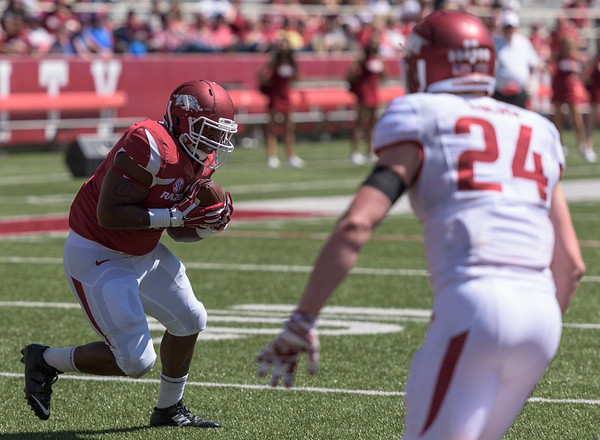 Fullback Chris Jones catches the ball and just has to get past Defensive Back Ryder Lucas to score during the Arkansas Red-White Spring Football Game on Saturday, April 25, 2015 in Fayetteville, Arkansas at Donald W. Reynolds Razorback Stadium.  The Red team won 62-18 in front of an official attendance of 41,220 fans.   (Alan Jamison, Nate Allen Sports Service)