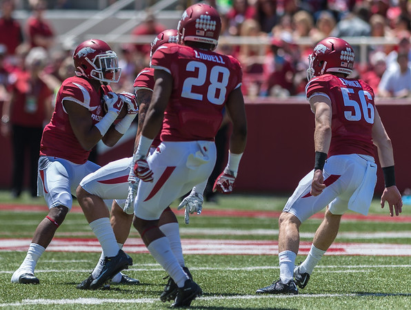 Matt Emrich and Josh Liddell prepare to block during a punt return during the Arkansas Red-White Spring Football Game on Saturday, April 25, 2015 in Fayetteville, Arkansas at Donald W. Reynolds Razorback Stadium.  The Red team won 62-18 in front of an official attendance of 41,220 fans.   (Alan Jamison, Nate Allen Sports Service)