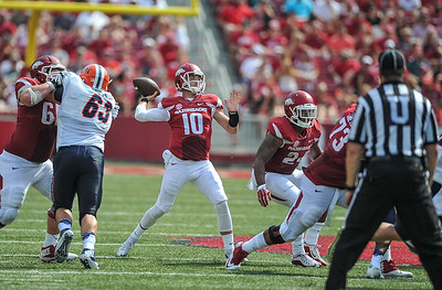 Arkansas Razorbacks quarterback Brandon Allen (10) passes for a touchdown during a football game between the Arkansas Razorbacks and the UTEP Miners on Saturday, September 5, 2015 at the  Donald W. Reynolds Razorback Stadium in Fayetteville, Arkansas.  Arkansas won the game 48-13.  (Alan Jamison, Nate Allen Sports Service).
