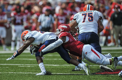 Arkansas Razorbacks linebacker Josh Williams (21) with a tackle during a football game between the Arkansas Razorbacks and the UTEP Miners on Saturday, September 5, 2015 at the  Donald W. Reynolds Razorback Stadium in Fayetteville, Arkansas.  Arkansas won the game 48-13.  (Alan Jamison, Nate Allen Sports Service).