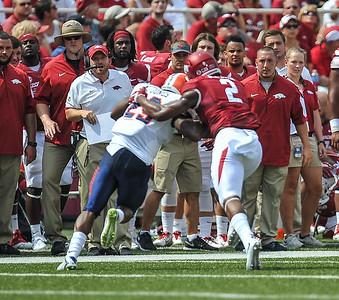 Arkansas Razorbacks defensive back D.J. Dean (2) with a tackle during a football game between the Arkansas Razorbacks and the UTEP Miners on Saturday, September 5, 2015 at the  Donald W. Reynolds Razorback Stadium in Fayetteville, Arkansas.  Arkansas won the game 48-13.  (Alan Jamison, Nate Allen Sports Service).