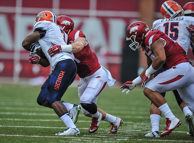 Arkansas Razorbacks linebacker Brooks Ellis (51) with a tackle during a football game between the Arkansas Razorbacks and the UTEP Miners on Saturday, September 5, 2015 at the  Donald W. Reynolds Razorback Stadium in Fayetteville, Arkansas.  Arkansas won the game 48-13.  (Alan Jamison, Nate Allen Sports Service).