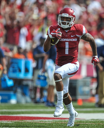 Arkansas Razorbacks wide receiver Jared Cornelius (1) runs for a touchdown during a football game between the Arkansas Razorbacks and the UTEP Miners on Saturday, September 5, 2015 at the  Donald W. Reynolds Razorback Stadium in Fayetteville, Arkansas.  Arkansas won the game 48-13.  (Alan Jamison, Nate Allen Sports Service).