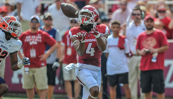 Keon Hatcher catches a touchdown pass during a football game between the Arkansas Razorbacks and the UTEP Miners on Saturday, September 5, 2015 at the  Donald W. Reynolds Razorback Stadium in Fayetteville, Arkansas.  Arkansas won the game 48-13.  (Alan Jamison, Nate Allen Sports Service).
