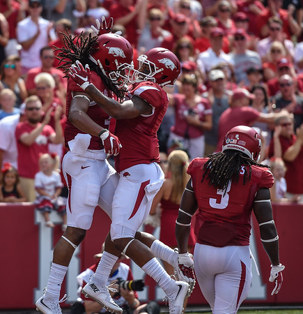 Arkansas Razorbacks wide receiver Jared Cornelius (1) celebrates with Arkansas Razorbacks wide receiver Keon Hatcher (4) after Keon catches a pass for a touchdown during a football game between the Arkansas Razorbacks and the UTEP Miners on Saturday, September 5, 2015 at the  Donald W. Reynolds Razorback Stadium in Fayetteville, Arkansas.  Arkansas won the game 48-13.  (Alan Jamison, Nate Allen Sports Service).