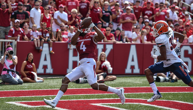 Arkansas Razorbacks wide receiver Keon Hatcher (4) with a touchdown catch during a football game between the Arkansas Razorbacks and the UTEP Miners on Saturday, September 5, 2015 at the  Donald W. Reynolds Razorback Stadium in Fayetteville, Arkansas.  Arkansas won the game 48-13.  (Alan Jamison, Nate Allen Sports Service).