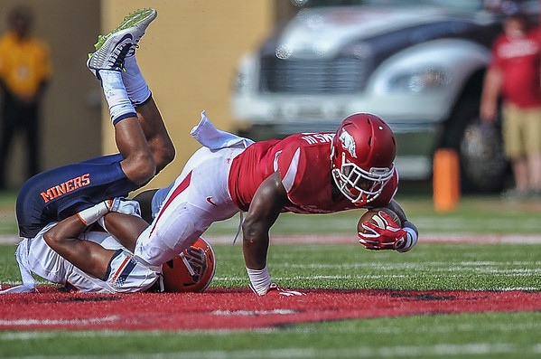 Rawleigh Williams with a carry during a football game between the Arkansas Razorbacks and the UTEP Miners on Saturday, September 5, 2015 at the  Donald W. Reynolds Razorback Stadium in Fayetteville, Arkansas.  Arkansas won the game 48-13.  (Alan Jamison, Nate Allen Sports Service).