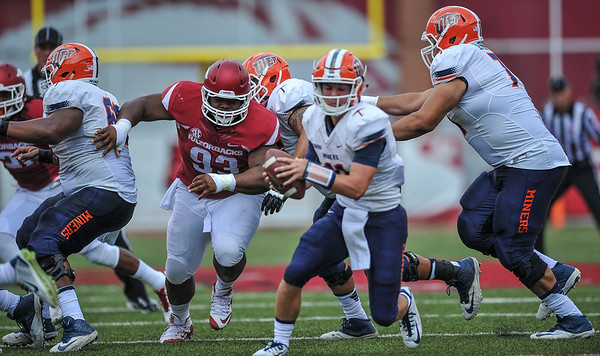 Arkansas Razorbacks defensive lineman DeMarcus Hodge (93) closes on the quarterback during a football game between the Arkansas Razorbacks and the UTEP Miners on Saturday, September 5, 2015 at the  Donald W. Reynolds Razorback Stadium in Fayetteville, Arkansas.  Arkansas won the game 48-13.  (Alan Jamison, Nate Allen Sports Service).