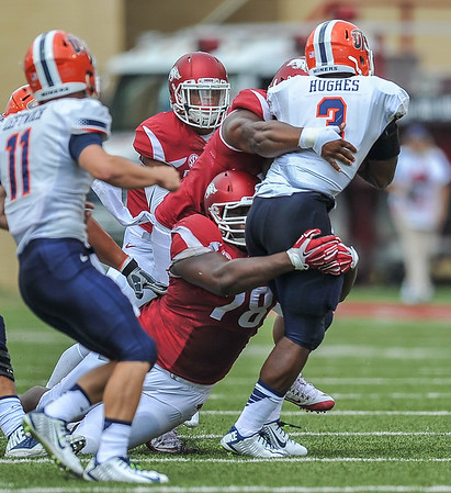 Bijhon Jackson (low) and DeMarcus Hodge (high) share a tackle during a football game between the Arkansas Razorbacks and the UTEP Miners on Saturday, September 5, 2015 at the  Donald W. Reynolds Razorback Stadium in Fayetteville, Arkansas.  Arkansas won the game 48-13.  (Alan Jamison, Nate Allen Sports Service).