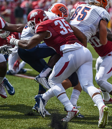 Dwayne Eugene with a tackle during a football game between the Arkansas Razorbacks and the UTEP Miners on Saturday, September 5, 2015 at the  Donald W. Reynolds Razorback Stadium in Fayetteville, Arkansas.  Arkansas won the game 48-13.  (Alan Jamison, Nate Allen Sports Service).