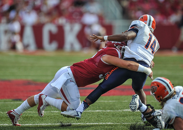 Arkansas Razorbacks defensive lineman Karl Roesler (96) with a tackle during a football game between the Arkansas Razorbacks and the UTEP Miners on Saturday, September 5, 2015 at the  Donald W. Reynolds Razorback Stadium in Fayetteville, Arkansas.  Arkansas won the game 48-13.  (Alan Jamison, Nate Allen Sports Service).