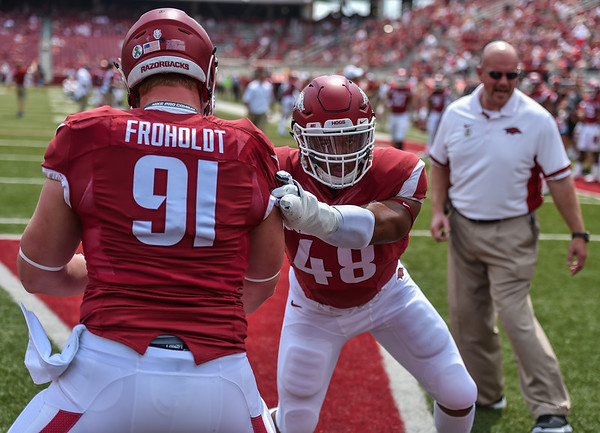 Deatrich Wise warms up with Hjalte Froholdt before a football game between the Arkansas Razorbacks and the UTEP Miners on Saturday, September 5, 2015 at the  Donald W. Reynolds Razorback Stadium in Fayetteville, Arkansas.  Arkansas won the game 48-13.  (Alan Jamison, Nate Allen Sports Service).