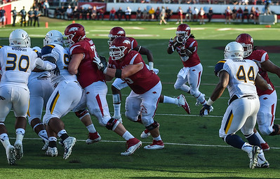 Alex Collins with the ball during a football game between the Arkansas Razorbacks and the Toledo Rockets on Saturday, 9/12/2015.  Toledo won 16-12.   (Alan Jamison, Nate Allen Sports Service)
