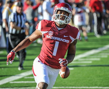 Jared Cornelius in the end zone after running a punt back for a touchdown that was called back due to a penalty during a football game between the Arkansas Razorbacks and the Toledo Rockets on Saturday, 9/12/2015.  Toledo won 16-12.   (Alan Jamison, Nate Allen Sports Service)