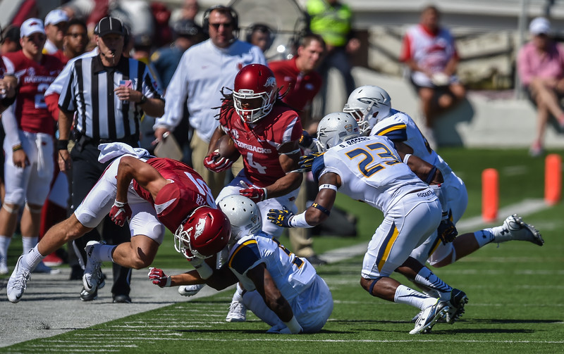 Keon Hatcher with a pass reception in a football game between the Arkansas Razorbacks and the Toledo Rockets on Saturday, 9/12/2015.  Toledo won 16-12.   (Alan Jamison, Nate Allen Sports Service)