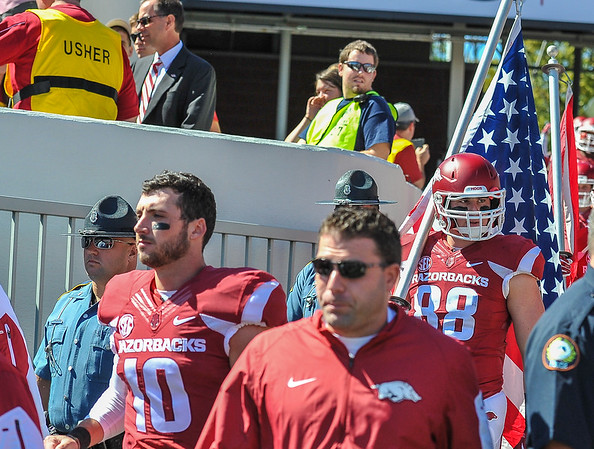 Alex Volzke (88) and Brandon Allen (10) enter the stadium just prior to the football game between the Arkansas Razorbacks and the Toledo Rockets on Saturday, 9/12/2015.  Toledo won 16-12.   (Alan Jamison, Nate Allen Sports Service)