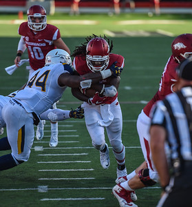 Toledo linebacker Jaylen Coleman tackles Alex Collins during a football game between the Arkansas Razorbacks and the Toledo Rockets on Saturday, 9/12/2015.  Toledo won 16-12.   (Alan Jamison, Nate Allen Sports Service)