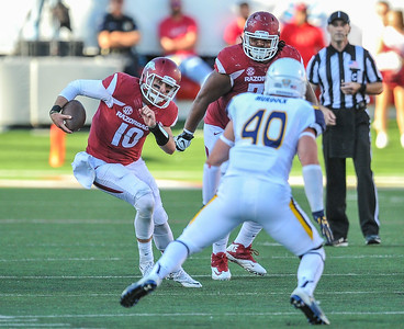 Brandon Allen scrambles during a football game between the Arkansas Razorbacks and the Toledo Rockets on Saturday, 9/12/2015.  Toledo won 16-12.   (Alan Jamison, Nate Allen Sports Service)