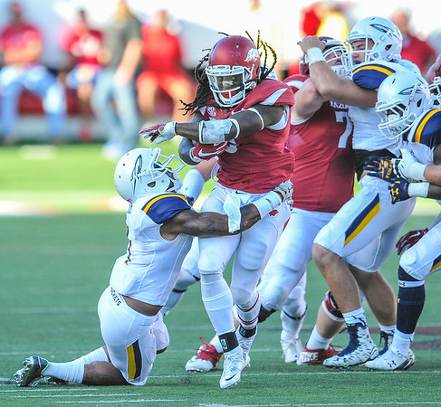 Alex Collins carries the ball during a football game between the Arkansas Razorbacks and the Toledo Rockets on Saturday, 9/12/2015.  Toledo won 16-12.   (Alan Jamison, Nate Allen Sports Service)