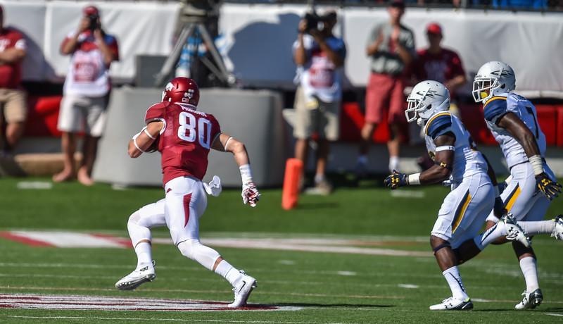 Drew Morgan runs after catching a pass during a football game between the Arkansas Razorbacks and the Toledo Rockets on Saturday, 9/12/2015.  Toledo won 16-12.   (Alan Jamison, Nate Allen Sports Service)