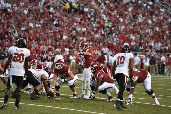 Brandon Allen reads the defense during the first half of a football game between the Arkansas Razorbacks and the Texas Tech Red Raiders at Reynolds Razorback Stadium at the University of Arkansas in Fayetteville, Arkansas.   (Alan Jamison, Nate Allen Sports Service)