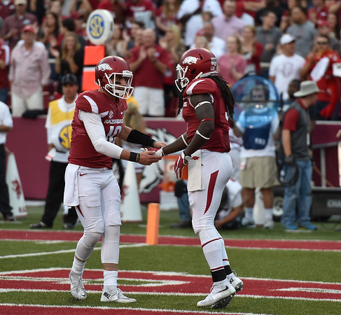 Brandon Allen (10) congratulates Alex Collins (3) after a rushing touchdown during the first half of a football game between the Arkansas Razorbacks and the Texas Tech Red Raiders at Reynolds Razorback Stadium at the University of Arkansas in Fayetteville, Arkansas.   (Alan Jamison, Nate Allen Sports Service)