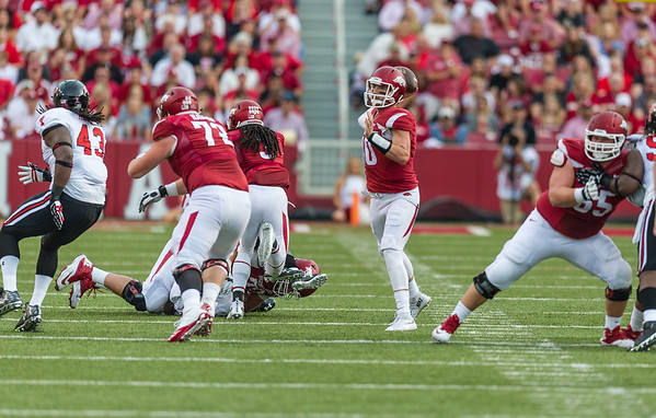 Arkansas quarterback Brandon Allen (10) passes during a football game between the Arkansas Razorbacks and the Texas Tech Red Raiders at Reynolds Razorback Stadium at the University of Arkansas in Fayetteville, Arkansas.   Texas Tech won 35-24.  (Alan Jamison, Nate Allen Sports Service)