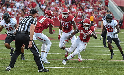 Alex Collins (3) with the carry during a football game between the Arkansas Razorbacks and the Texas Tech Red Raiders at Reynolds Razorback Stadium at the University of Arkansas in Fayetteville, Arkansas.   Texas Tech won 35-24.  (Alan Jamison, Nate Allen Sports Service)