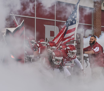Arkansas players enter the field during a football game between the Arkansas Razorbacks and the Texas Tech Red Raiders at Reynolds Razorback Stadium at the University of Arkansas in Fayetteville, Arkansas.   Texas Tech won 35-24.  (Alan Jamison, Nate Allen Sports Service)