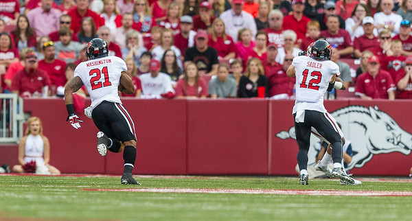 Texas Tech running back DeAndre Washington (21) with a carry during a football game between the Arkansas Razorbacks and the Texas Tech Red Raiders at Reynolds Razorback Stadium at the University of Arkansas in Fayetteville, Arkansas.   Texas Tech won 35-24.  (Alan Jamison, Nate Allen Sports Service)