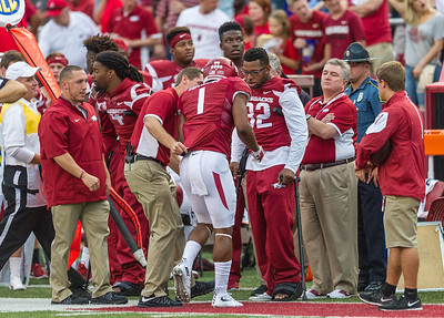 Arkansas wide receiver Jared Cornelius (1) leaves the field with an injured left arm after a reception during a football game between the Arkansas Razorbacks and the Texas Tech Red Raiders at Reynolds Razorback Stadium at the University of Arkansas in Fayetteville, Arkansas.   Texas Tech won 35-24.  (Alan Jamison, Nate Allen Sports Service)