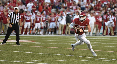 Brandon Allen looks downfield during the first half of a football game between the Arkansas Razorbacks and the Texas Tech Red Raiders at Reynolds Razorback Stadium at the University of Arkansas in Fayetteville, Arkansas.   (Alan Jamison, Nate Allen Sports Service)