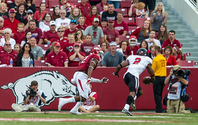 Texas Tech wide receiver Reginald Davis (2) runs past Arkansas corner back DJ Dean (2) for a touchdown during a football game between the Arkansas Razorbacks and the Texas Tech Red Raiders at Reynolds Razorback Stadium at the University of Arkansas in Fayetteville, Arkansas.   Texas Tech won 35-24.  (Alan Jamison, Nate Allen Sports Service)