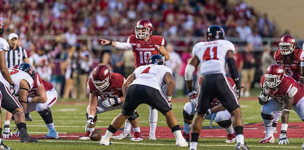 Arkansas quarterback Brandon Allen (10) reads the defense during a football game between the Arkansas Razorbacks and the Texas Tech Red Raiders at Reynolds Razorback Stadium at the University of Arkansas in Fayetteville, Arkansas.   Texas Tech won 35-24.  (Alan Jamison, Nate Allen Sports Service)
