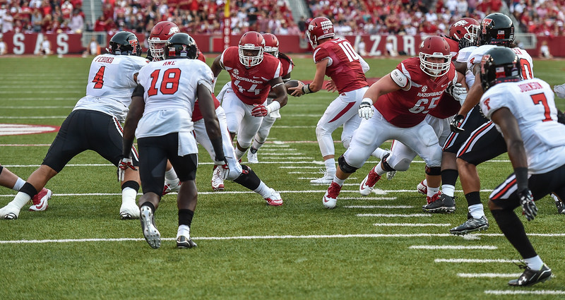 Arkansas fullback Kendrick Jackson (44) blocks for a carry by Alex Collins (3) during a football game between the Arkansas Razorbacks and the Texas Tech Red Raiders at Reynolds Razorback Stadium at the University of Arkansas in Fayetteville, Arkansas.   Texas Tech won 35-24.  (Alan Jamison, Nate Allen Sports Service)