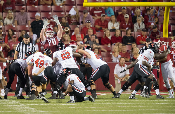 Arkansas offensive tackle Dan Skipper (70) just misses blocking a Texas Tech field goal attempt during a football game between the Arkansas Razorbacks and the Texas Tech Red Raiders at Reynolds Razorback Stadium at the University of Arkansas in Fayetteville, Arkansas.   Texas Tech won 35-24.  (Alan Jamison, Nate Allen Sports Service)