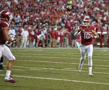 Brandon Allen passes to Hunter Henry for a touchdown during the first half of a football game between the Arkansas Razorbacks and the Texas Tech Red Raiders at Reynolds Razorback Stadium at the University of Arkansas in Fayetteville, Arkansas.   (Alan Jamison, Nate Allen Sports Service)